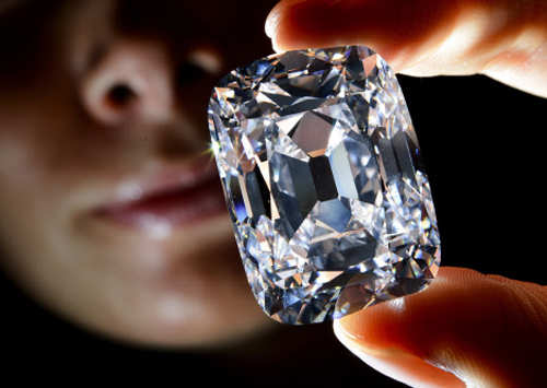 A model holds the 'Archduke Joseph' historical diamond on October 3, 2012 during a Christie's auction preview in Geneva. (AFP)