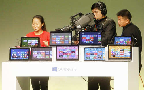 A student shares her experience of using Windows 8 as she speaks to the media during a Microsoft promotional event ahead of the launch of Windows 8, in Shanghai on October 23, 2012. (REUTERS)