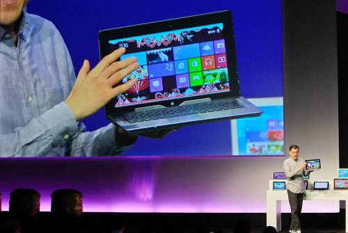 Wei Qing, General Manager of Consumer Marketing at Microsoft China introduces the company's new tablet computer and Windows 8 software to the media in Shanghai on October 23, 2012. (AFP)
