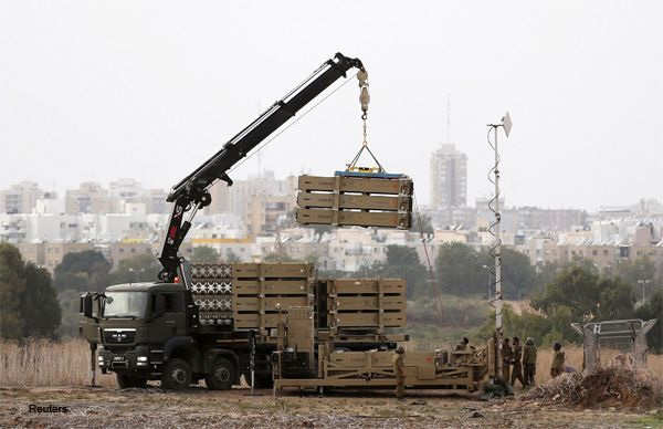 A crane offloads a battery of Iron Dome missiles in the southern city of Ashdod on November 17, 2012.