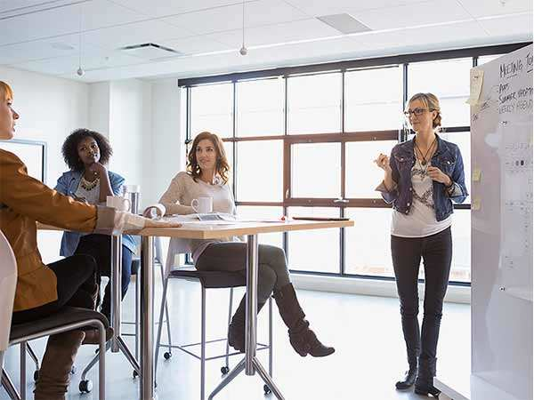 Want to shine in your new job? Talk less, listen more in meetings, and dress well