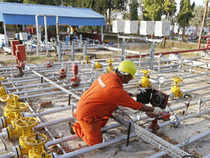 A technician works inside ONGC group gathering station