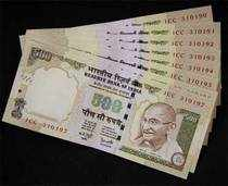 Rupee sinks to record lows of 53.97 vs dollar
