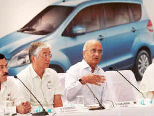 Maruti Suzuki Managing Director and CEO Shinzo Nakanishi (2nd from L), chairman RC Bhargava (3rd from L) with other officials in New Delhi on Saturday. (PTI)