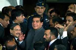 A long-running standoff between Pak's SC and the civilian government over corruption charges against Zardari reached an interim resolution.
