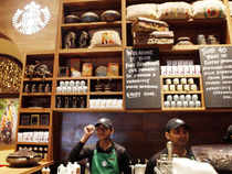 Employees of the newly inaugurated first India outlet of Starbucks work at a counter in Mumbai on Friday, Oct 19, 2012. (AP)