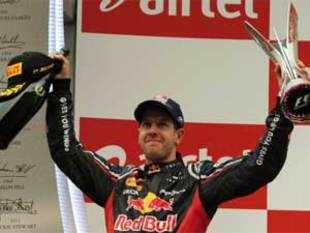 Sebastian Vettel retained his Indian Grand Prix title after successfully staving off the challenge from Ferrari's Fernando Alonso to win a thrilling race