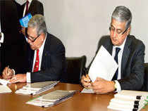 UB chairman Vijay Mallya and Diageo's Chief Operating Officer Ivan Menezes sign the deal on Friday. The deal may spur other MNCs looking to expand their India presence to scout for local targets and alliances.