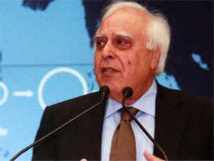 Kapil Sibal blamed the erudition of CAG, the media and the court' for the policy paralysis and asserted that the government continues to take decisions