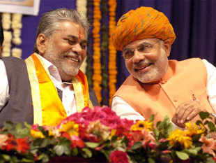 Gujarat Chief Minister Narendra Modi sharing a lighter moment with state BJP President Purushottam Rupala.