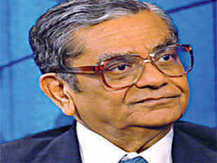 Jagdish N Bhagwati says Manmohan Singh's hands are tied because India's political system is similar to that of the former Soviet Union, where the party was supreme and the chief of government just a figurehead.