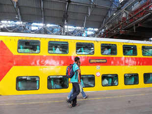 The 12-coach AC double decker train with fire alarm system is expected to be pressed into service by February next year, a senior Railway Ministry official said.
