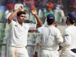 Ashwin celebrates the dismissal of Alister Cook with team mates during the third day of the second test in Mumbai on Sunday. (PTI photo)