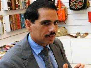 "BJP today hit out at the Prime Minister's Office for giving a ""clean chit"" to Robert Vadra in the land deals with realty major DLF."