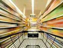 The government appeared poised to scrape through a crucial parliamentary vote on allowing foreign firms to set up supermarkets.