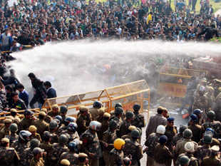 sustained protests over the gang rape of the 23-year-old paramedical student erupted in Raisina Hill, the seat of power, as thousands of youth clashed with police undeterred by the repeated use of water cannons, teargas shells and baton charge.