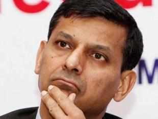"""Rajan further said that the revised fiscal deficit target of 5.3 per cent of GDP is achievable, but it would require """"a fair amount of painful decisions""""."""