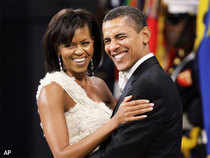 While US President Barack Obama and his Cabinet received mixed reviews in a new opinion poll, the first lady Michelle Obama and Secretary of State Hillary Clinton have scored high marks for their performance.
