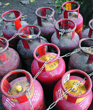 The government's efforts to check diversion of cheap cooking gas cylinders and prune freebies by capping supplies are paying off by saving approximately Rs 764 crore in subsidy outgo.