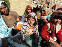 Grief stricken mother (right), wife (back) with children of martyr LNk Hemraj Singh who was killed by Pakistani soldiers in Poonch border recently, at their village near Mathura. BCCL