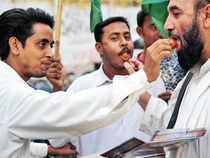 Activists of Pasban Pakistan celebrate the Supreme Court order to arrest prime minister Raja Pervez Ashraf, in Karachi on Tuesday — AFP