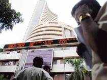 Sensex surged over 100 pts in mid-morning trade to hit its fresh 52-week high of 20126.55, led by gains in ONGC, ICICI Bank and ITC.