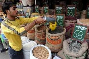 Panel on food has indicated that govt may revise prices of food grains distributed through food security scheme to contain the widening fiscal deficit.