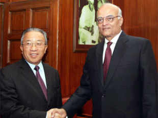National Security Adviser Shivshankar Menon shakes hands with Chinese State Councilor Dai Bingguo during a meeting in New Delhi on Friday. PTI