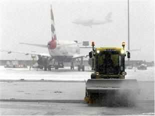 European airports from London to Frankfurt suspended hundreds of flights and worked to overcome bottlenecks from weekend cancellations as snow and ice swept across the continent and disrupted travel for a second week.