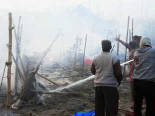 Smoke shroud the tents after a fire broke out at a camp during Maha Kumbh Mela in Allahabad. (PTI)
