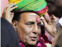 BJP president Rajnath Singh took on home minister Sushil Kumar Shinde over his Hindu terror remarks daring him to ban RSS and BJP.