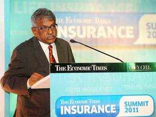 Banking, insurance and MFs should be run as separate businesses with different shareholders and one should not venture into other, says Irda chief.  In pic: IRDA chief J Hari Narayan addressing 'The Economic Times INSURANCE Summit 2011' in Mumbai.
