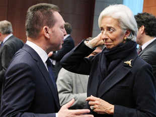 Greek Finance Minister Yannis Stournaras, talks with International Monetary Fund managing director Christine Lagarde, during the Eurogroup meeting, at the European Council building in Brussels.Finance ministers from the 17 euro countries gathered in Brussels.
