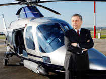 Giuseppe Orsi poses next to a helicopter during the opening ceremony of the new Terminal of Vertiporto dell'Urbe in Rome in this January 19, 2009 file photo. (Reuters)