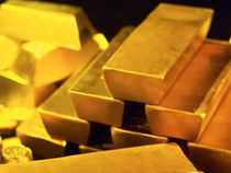 Gold slumped to a fresh six-month low and closed below the psychological Rs 30,000 per 10 gm mark at the bullion market on aggressive unwinding by stockists and traders