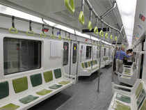 In Pic: A group of people travel in one of the 45 new train wagons that were bought from China's CNR, in a Buenos Aires' subway station on February 14, 2013.