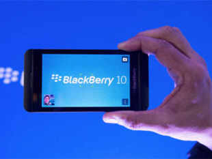 In Pic: (File photo) Arun Kumar, a senior product manager for BlackBerry, shows off the new BlackBerry 10 during the global launch of the new Blackberry 10 smartphones in Toronto on January 30, 2013.