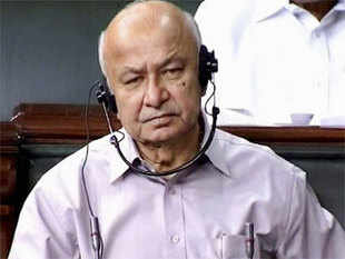 As dust settles on the 'Hindu terror' issue, government has said Home Minister Sushilkumar Shinde had not apologised for his controversial remarks but only expressed regret, which was accepted by BJP. (Pic: PTI)