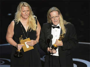 Karen Baker Landers, left, and Per Hallberg accept the award for best sound editing for 'Skyfall' during the Oscars at the Dolby Theatre in Los Angeles (AP)