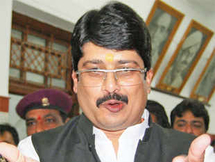 IN NEWS FOR WRONG REASONS: Raja Bhaiya addressing the media after resigning as food & civil supplies minister, in Lucknow on March 4, 2013.