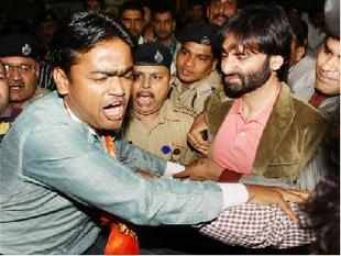 JKLF leader Yasin Malik returned to India today amid protests by Shiv Sena activists at the airport here.