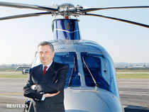 Finmeccanica Chairman and Chief Executive Officer Giuseppe Orsi poses next to a helicopter (File)