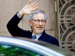 "Steven Spielberg waves to the media as he leaves Anil Ambani's office in Mumbai, on March 11, 2013. Spielberg is in India to celebrate the success of his Oscar-winning film ""Lincoln"" co-produced by Ambani's Reliance Entertainment. (AP Photo)"