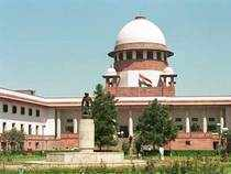 """Why a small group of cos have been """"picked and chosen"""" for allocation of coal blocks out of the large number of companies that applied for it, SC asks centre."""