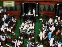 """Lok Sabha was adjourned briefly during Question Hour today after uproar over """"neglect"""" of Hindi and other regional languages in the Union Public Service Commission examinations, with SP and RJD members trooping into the Well to register their protest."""