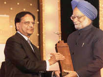 Anji Reddy accepts the Corporate Citizen of the year award on behalf of Dr Reddy's Foundation from PM Manmohan Singh