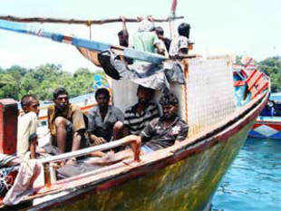 Sri Lankan Navy today intercepted a boat carrying 97 Tamil-origin Lankans, including 40 children, believed to be on their way to Australia illegally.