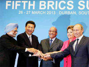 Prime Minsiter Manmohan Singh with Chinese President Xi Jinping, South African President, Jacob Zuma, Brazil's President, Dilma Rousseff, and Russian President Vladimir Putin during the family photo at the Fifth BRICS Summit in Durban, South Africa on March 27, 2013
