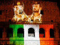 Pictures of Italian marines detained in India, Salvatore Girone (R) and Massimiliano Latorre, are projected together with the colours of the Italian flag on the Colosseum in Rome, April 3, 2013. Reuters