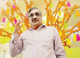 Slowdown-hit retailer Kishore Biyani now out of 'ivory Tower', spends time on the floor with employees